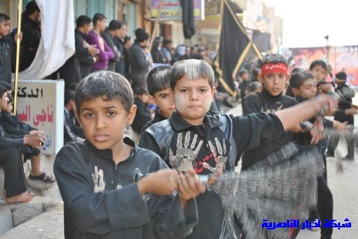 رسالة عاشوراء:احياء المواكب الحسينية لذكرى واقعة الطف في مدينة الطف - تقرير مصور- Nasiriyah019